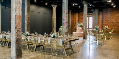 Industrial venue with gold tables and chairs