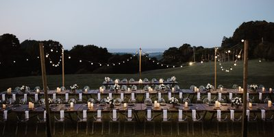 Outdoor dining function with fairy lights